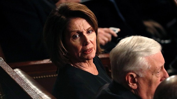 U.S. House Minority Leader Nancy Pelosi reacts as she sits with House Minority Whip Steny Hoyer as U.S. President Donald Trump delivers his State of the Union address to a joint session of the U.S. Congress on Capitol Hill in Washington, U.S. January 30, 2018. REUTERS/Leah Millis - HP1EE1V0A7F0L
