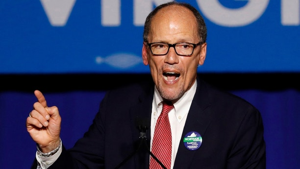 Democratic National Committee Chairman Tom Perez speaks at Ralph Northam's election night rally on the campus of George Mason University in Fairfax, Virginia, November 7, 2017. REUTERS/Aaron P. Bernstein - HP1EDB80BPO1W