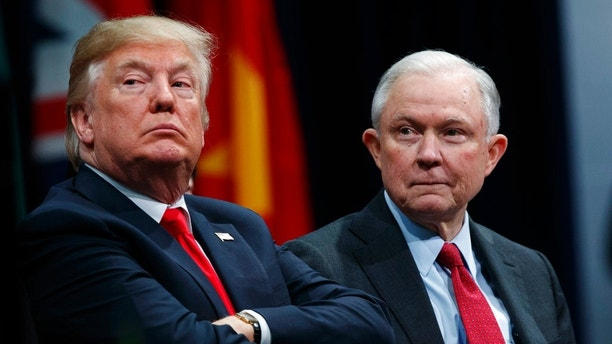 "FILE - In this Dec. 15, 2017 file photo, President Donald Trump, left, sits with Attorney General Jeff Sessions during the FBI National Academy graduation ceremony in Quantico, Va. The Trump administration on Tuesday, Jan. 16, 2018, appealed a judge's ruling temporarily blocking its decision to end protections for hundreds of thousands of young immigrants and announced plans to seek U.S. Supreme Court review even before the appeals court issues a decision. Sessions said in a statement that it defied "" law and common sense"" for a single federal judge to decide the Deferred Action for Childhood Arrivals issue. (AP Photo/Evan Vucci, File)"