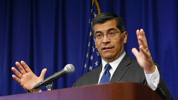 California Attorney General Xavier Becerra discusses reports that wide-spread federal immigration raids may be planned soon in Northern California, at a news conference Thursday, Jan. 18, 2018, in Sacramento, Calif. Becerra warned employers that they must comply with a new California law that limits their cooperation with immigration officials. (AP Photo/Rich Pedroncelli)