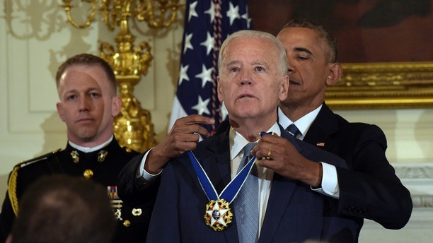 President Barack Obama presents Vice President Joe Biden with the Presidential Medal of Freedom during a ceremony in the State Dining Room of the White House in Washington, Thursday, Jan. 12, 2017. (AP Photo/Susan Walsh)