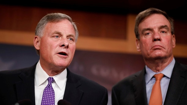 Sen. Richard Burr (R-NC), accompanied by Sen. Mark Warner (D-VA), gives an update on the ongoing investigation into Russian involvement in the 2016 election at the Capitol Building in Washington, U.S., October 4, 2017. REUTERS/Aaron P. Bernstein - RC1A700A3CA0