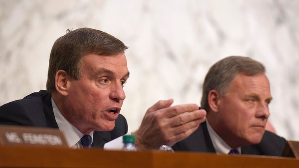 Senate Intelligence Committee Vice Chairman Sen. Mark Warner, D-Va., left, sitting next to Chairman Sen. Richard Burr, R-N.C., right, asks a question during a hearing about the Foreign Intelligence Surveillance Act, on Capitol Hill in Washington, Wednesday, June 7, 2017. (AP Photo/Susan Walsh)