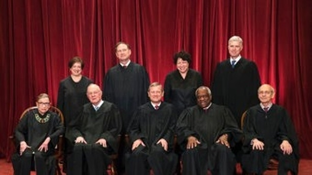 FILE - In this June 1, 2017, file photo, the justices of the U.S. Supreme Court gather for an official group portrait to include new Associate Justice Neil Gorsuch, top row, far right at the Supreme Court Building in Washington. Seated, from left are, Associate Justice Ruth Bader Ginsburg, Associate Justice Anthony M. Kennedy, Chief Justice John Roberts, Associate Justice Clarence Thomas, and Associate Justice Stephen Breyer. Standing, from left are, Associate Justice Elena Kagan, Associate Justice Samuel Alito Jr., Associate Justice Sonia Sotomayor, and Associate Justice Neil Gorsuch. In different circumstances, Ginsburg might be on a valedictory tour in her final months on the Supreme Court. But in the era of Donald Trump, the 84-year-old Ginsburg is packing her schedule and sending signals she intends to keep her seat on the bench for years. (AP Photo/J. Scott Applewhite, File)