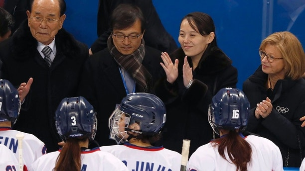Ice Hockey – Pyeongchang 2018 Winter Olympics – Women Preliminary Round Match - Switzerland v Korea - Kwandong Hockey Centre, Gangneung, South Korea – February 10, 2018 - Kim Yo Jong claps as she stands near Kim Yong Nam in front of Korea players. REUTERS/Grigory Dukor - HP1EE2A15BUEI