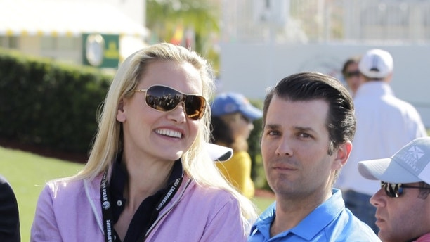 FILE - In this March 6, 2016 file photo, Donald Trump Jr. and his wife Vanessa ride in a golf cart during the final round of the Cadillac Championship golf tournament, in Doral, Fla. Police say Vanessa Trump opened an envelope that contained white powder, felt ill and was taken to New York City hospital as a precaution. A police department spokesman says a preliminary test of the powder indicated it wasn't dangerous. (AP Photo/Luis Alvarez, File)