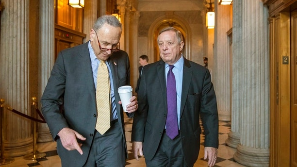 "Senate Minority Leader Chuck Schumer, D-N.Y., left, and Sen. Dick Durbin, D-Ill., right, walk outside the chamber during debate in the Senate on immigration, at the Capitol in Washington, Wednesday, Feb. 14, 2018. Schumer said on the Senate floor that ""the one person who seems most intent on not getting a deal is President Trump."" (AP Photo/J. Scott Applewhite)"