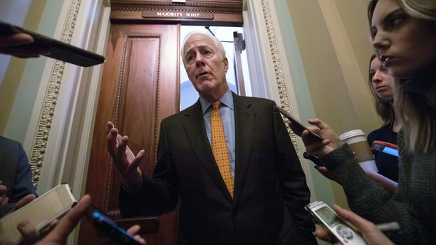 With no apparent indications of a breakthrough in the Senate to avoid a government shutdown, Majority Whip John Cornyn, R-Texas, speaks briefly with reporters outside his office on Capitol Hill in Washington, Friday, Jan. 19, 2018. (AP Photo/J. Scott Applewhite)