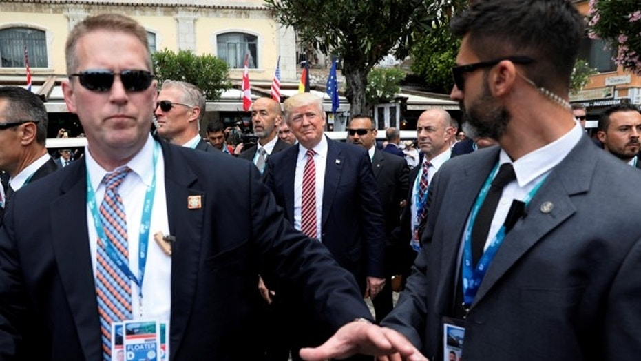 President Donald Trump is surrounded by Secret Service in this file photo from Taormina, Sicily, Italy, on May 26, 2017.