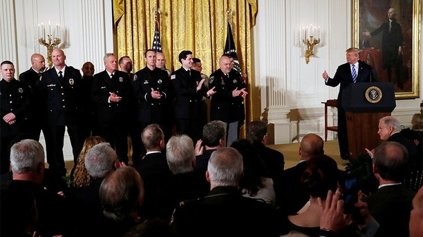 U.S. President Donald Trump applauds for Medal of Valor recipients during a Public Safety Medal of Valor Awards Ceremony at the White House in Washington, U.S., February 20, 2018. REUTERS/Leah Millis - RC16E8DA4CE0
