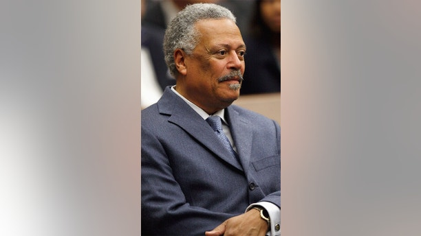 FILE - In this May 1, 2008 file photo, U.S. District Judge Emmet G. Sullivan is pictured during a ceremony at the federal courthouse in Washington. The special prosecutor who investigated the botched case against late Alaska Sen. Ted Stevens is not recommending criminal charges against any of the Justice Department attorneys who tried him despite finding widespread misconduct beyond what has yet been publicly revealed.  (AP Photo/Charles Dharapak)