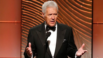 Jeopardy television game show host Alex Trebek speaks on stage during the 40th annual Daytime Emmy Awards in Beverly Hills, California June 16, 2013. REUTERS/Danny Moloshok (UNITED STATES - Tags: ENTERTAINMENT) - GM1E96H14VS01