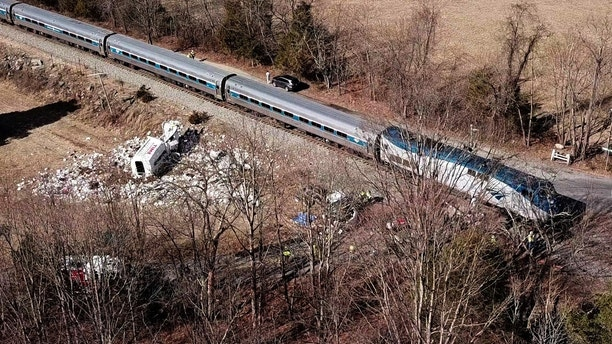 The wreckage of a garbage truck lies beside an Amtrak passenger train after a collision in Crozet, Virginia, U.S. January 31, 2018.  REUTERS/Drone Base - RC170B81C380