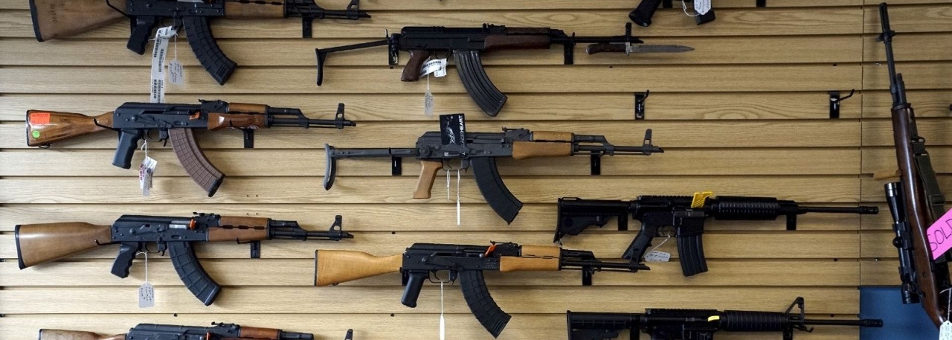 A selection of AK and AR rifles are seen for sale at the Pony Express Firearms shop in Parker, Colorado December 7, 2015. Many Americans are stocking up on weapons after the country's worst mass shooting in three years. Gun retailers are reporting surging sales, with customers saying they want to keep handguns and rifles at hand for self-defense in the event of another attack. REUTERS/Rick Wilking - GF10000257913