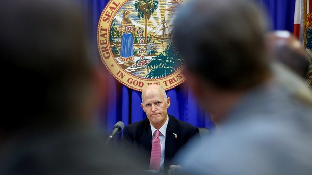 Florida Governor Rick Scott listens during a meeting with law enforcement, mental health, and education officials about how to prevent future tragedies in the wake of last week's mass shooting at Marjory Stoneman Douglas High School, at the Capitol in Tallahassee, Florida, U.S., February 20, 2018. REUTERS/Colin Hackley - RC1D5FAFB920