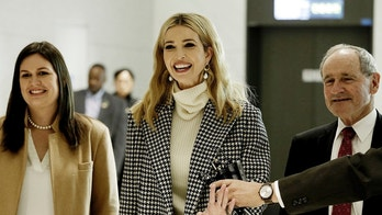 Flanked by White House Press Secretary Sarah Huckabee Sanders, left, Ivanka Trump, advisor to and daughter of U.S. President Donald Trump, speaks as she arrives at the Incheon International Airport in Incheon, South Korea, Friday, Feb. 23, 2018. Ivanka will lead her country's delegation to the closing ceremony of the Pyeongchang Winter Olympics Sunday. (AP Photo/Ahn Young-joon. Pool)