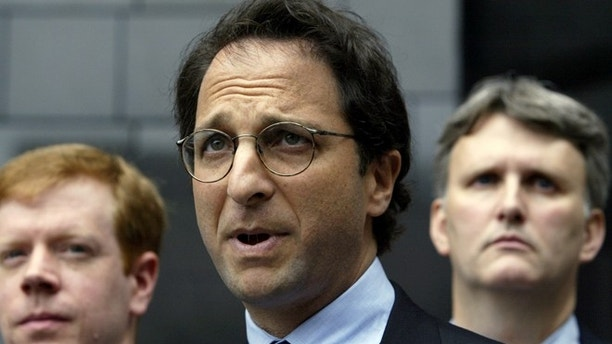 Federal prosecutor Andrew Weissmann (C) is flanked by FBI agents as he