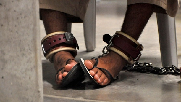 "FILE PHOTO -  In this photo, reviewed by a U.S. Department of Defense official, a Guantanamo detainee's feet are shackled to the floor as he attends a ""Life Skills"" class inside the Camp 6 high-security detention facility at Guantanamo Bay U.S. Naval Base April 27, 2010. REUTERS/Michelle Shephard/Pool/File Photo    - S1AETVRIQWAA"