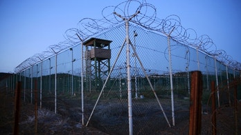 FILE PHOTO -  Chain link fence and concertina wire surrounds a deserted guard tower within Joint Task Force Guantanamo's Camp Delta at the U.S. Naval Base in Guantanamo Bay, Cuba March 21, 2016.  REUTERS/Lucas Jackson/File Photo - S1AETVRIRPAA