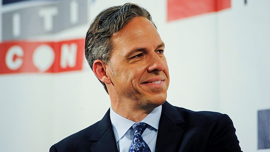 CNN anchor Jake Tapper appears on stage at Politicon, at the Pasadena Convention Center in Pasadena, Calif., July 29, 2017.