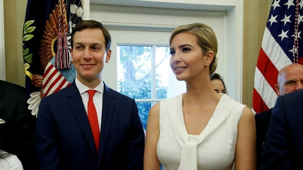White House Senior Adviser Jared Kushner and Ivanka Trump stand together after John Kelly was sworn in as White House Chief of Staff in the Oval Office of the White House in Washington, U.S., July 31, 2017. REUTERS/Joshua Roberts - RC1EA6A12300