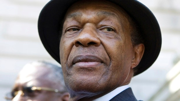 FILE - In this July 6, 2009 file photo, Washington District of Columbia Councilmember Mayor Marion Barry attends a news conference on the steps of Washington's city hall.  Marion Barry may be something of a political punchline to many Americans. But inside the District of Columbia, he is adored by many as a champion of civil rights and advocate for the city's poor and downtrodden.  (AP Photo/Manuel Balce Ceneta, File)