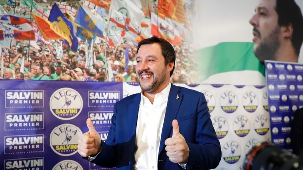 Right-wing, anti-immigrant and euroskeptic League's Matteo Salvini gives the thumbs up at the end of a press conference on the preliminary election results, in Milan, Monday, March 5, 2018. The League jumped from 4 percent of the vote five years ago to nearly 18 percent in Sunday's vote, ahead of Forza Italia, which had nearly 14 percent. (AP Photo/Luca Bruno)