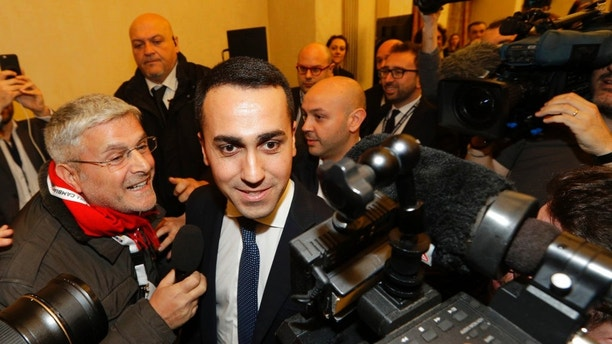 5-Stars Movement's leader Luigi Di Maio arrives for a press conference on the preliminary election results, in Rome, Monday, March 5, 2018. With the anti-establishment 5-Stars the highest vote-getter of any single party, the results confirmed the defeat of the two main political forces that have dominated Italian politics for decades — Forza Italia and the center-left Democrats — and the surging of populist and right-wing, euroskeptic forces that have burst onto the European scene.  (AP Photo/Andrew Medichini)