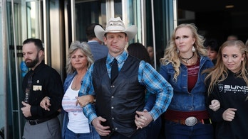 "FILE - In this Dec. 20, 2017, file photo, from left, Ryan Payne, Jeanette Finicum, widow of Robert ""LaVoy"" Finicum, Ryan Bundy, Angela Bundy, wife of Ryan Bundy and Jamie Bundy, daughter of Ryan Bundy, walk out of a federal courthouse in Las Vegas. Ryan Bundy, the eldest son of the Nevada rancher at the center of an armed standoff with federal agents in 2014, says, Thursday, March 8, 2018,  he'll mount an independent campaign for governor as a states' rights fundamentalist. (AP Photo/John Locher, file)"
