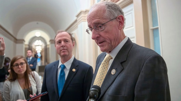 The leaders of the House Intelligence Committee, Rep. Adam Schiff, D-Calif., left, and Rep. Mike Conaway, R-Texas, emerge from a closed-door meeting at the Capitol with Sheryl Sandberg, chief operating officer of social media giant Facebook, amid the company's discovery of Russia-linked ads that ran before and after the 2016 election, in Washington, Wednesday, Oct. 11, 2017. (AP Photo/J. Scott Applewhite)