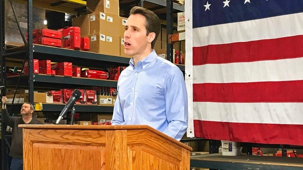Missouri Attorney General Josh Hawley kicks off his campaign to win the GOP nomination for U.S. Senate, Tuesday, March 13, 2018, in Raytown, Mo. Hawley says he hopes President Donald Trump comes to Missouri often to support his campaign against Democratic incumbent Sen. Claire McCaskill. (AP Photo/Margaret Stafford)