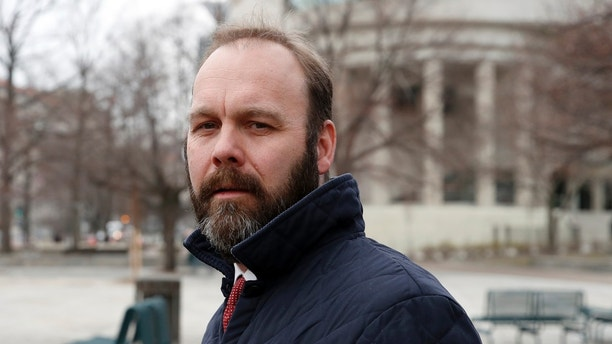 Rick Gates departs Federal District Court, Wednesday, Feb. 14, 2018, in Washington. Paul Manafort, the former campaign chairman for President Donald Trump, and his business associate Rick Gates were in federal court on Wednesday for a routine status conference. Both were indicted in October on charges stemming from foreign lobbying work in Ukraine. (AP Photo/Alex Brandon)