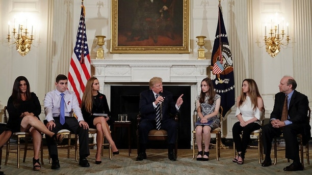 President Donald Trump speaks as he hosts a listening session with high school students, teachers and parents in the State Dining Room of the White House in Washington, Wednesday, Feb. 21, 2018. (AP Photo/Carolyn Kaster)