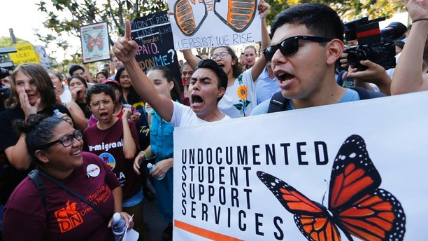 "Undocumented students join a rally in support of the Deferred Action for Childhood Arrivals, or DACA program outside the Edward Roybal Federal Building in downtown Los Angeles Friday, Sept. 1, 2017. President Donald Trump says he'll be announcing a decision on the fate of hundreds of thousands of young immigrants who were brought into the country illegally as children in the coming days, immigrants he's calling ""terrific"" and says he loves. Trump told reporters Friday, using a short-hand term for the nearly 800,000 young people who were given a reprieve from deportation and temporary work permits under the Obama-era DACA, program. (AP Photo/Damian Dovarganes)"
