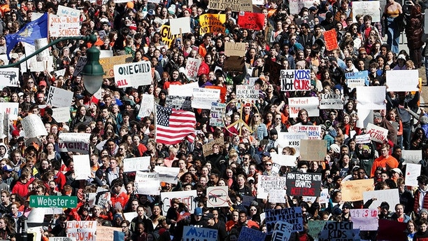 Students their way up East Washington Ave. toward the state Capitol during a walkout to protest gun violence, Wednesday, March 14, 2018, in Madison, Wis., one month after the deadly shooting inside a high school in Parkland, Fla.  (Steve Apps/Wisconsin State Journal via AP)