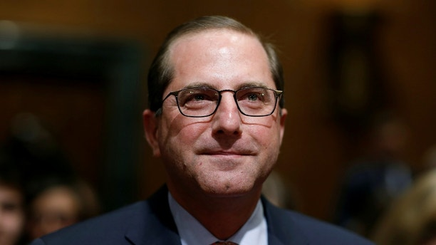 Alex Azar II prepares to testify before the Senate Finance Committee on his nomination to be Health and Human Services secretary in Washington, U.S., January 9, 2018.   REUTERS/Joshua Roberts - RC12344BD520
