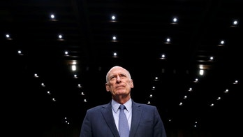 Director of National Intelligence (DNI) Daniel Coats prepares to testify to the Senate Armed Services Committee on Worldwide Threats on Capitol Hill in Washington, U.S., March 6, 2018.      REUTERS/Joshua Roberts - RC1D63FE3100