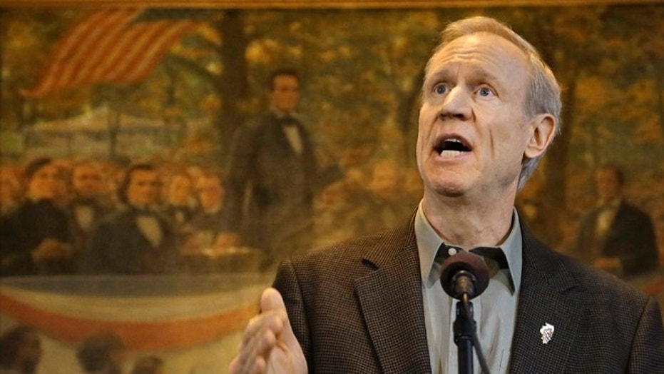 Feb. 9, 2015: Illinois Gov. Bruce Rauner speaks to reporters during a news conference in his office at the Illinois State Capitol in Springfield, Ill.