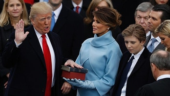 Donald Trump takes the oath of office as his wife Melania holds a bible and his son Barron looks on during his inauguration as the 45th president of the United States on the West front of the U.S. Capitol in Washington, U.S., January 20, 2017.  REUTERS/Lucy Nicholson - HT1ED1K1HCCMR