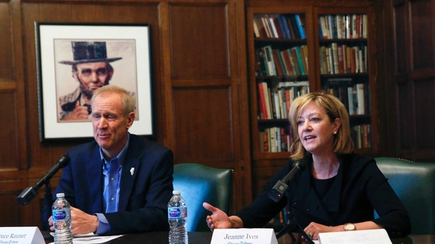 FILE - In this Jan. 29, 2018 file photo, Republican Gov. Bruce Rauner and primary challenger state Rep. Jeanne Ives, meet with the Chicago Tribune Editorial Board in Chicago. Six Democrats and Republican Gov. Rauner, who faces challenger Rep. Ives, are making their final pitches to voters this weekend before the Illinois primary on Tuesday, march 20, 2018. The winners in each party will face off in November. (Jose M. Osorio/Chicago Tribune via AP File)