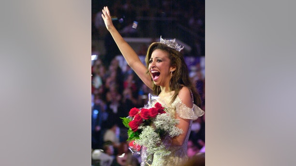 Miss Illinois Erika Harold waves after being crowned Miss America 2003
