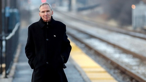 FILE PHOTO: U.S. Congressman Daniel Lipinski arrives at the Chicago Ridge Metra commuter train station before campaigning for re-election in Chicago Ridge, Illinois, U.S. January 25, 2018. Picture taken January 25, 2018. REUTERS/Kamil Krzacznski/File Photo - RC1F5B77DE20