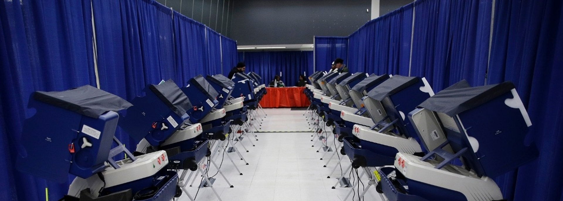 In this Tuesday, March 13, 2018 photo, voters cast their ballots in Illinois primary elections at the city's new early voting super site in downtown Chicago. In Illinois, attempts by hackers in the summer of 2016 to alter voter registration information were ultimately unsuccessful, although voter data was viewed. (AP Photo/Kiichiro Sato)