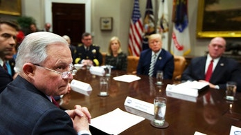 From back center clockwise; Homeland Security Secretary Kirstjen Nielsen, President Donald Trump, Immigration and Customs Enforcement Deputy Director Thomas Homan, Attorney General Jeff Sessions and Sen. Tom Cotton, R-Ark., listen to law enforcement officers speak during a roundtable talks on sanctuary cities hosted by Trump in the Roosevelt Room of the White House, in Washington, Tuesday, March 20, 2018. (AP Photo/Manuel Balce Ceneta)