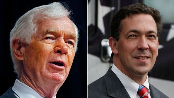 Mississippi Republican candidate, Sen. Thad Cochran speaks at the Mississippi War Memorial in Jackson, Miss., and State Sen. Chris McDaniel, R-Ellisville, prior to speaking at a rally on his behalf in Flowood, Miss., Monday, June 23, 2014.