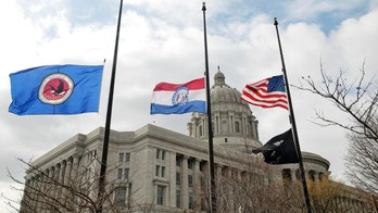 """Flags around the Missouri Capitol complex in Jefferson City were lowered to half staff Thursday, Feb. 26, 2015, after the death of State Auditor Tom Schweich, who died Thursday morning. Police in suburban St. Louis are calling the death of Schweich an """"apparent suicide."""" (AP Photo/The Jefferson City News-Tribune, Julie Smith)"""