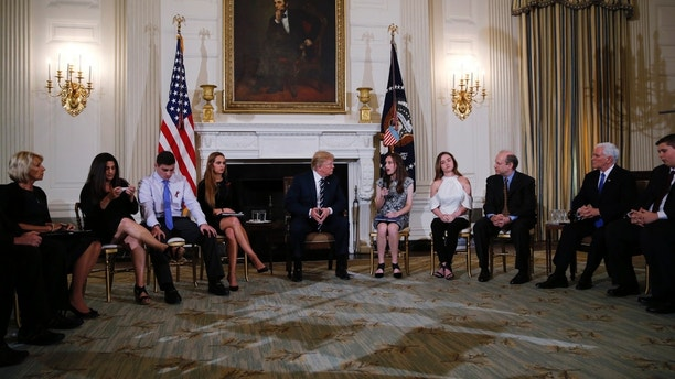 U.S. President Donald Trump hosts a listening session with high school students and teachers to discuss school safety at the White House in Washington, U.S., February 21, 2018. REUTERS/Jonathan Ernst - HP1EE2L1O8CHN