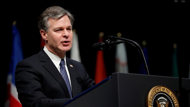 FILE PHOTO: FBI Director Christopher Wray delivers remarks to a graduation ceremony at the FBI Academy on the grounds of Marine Corps Base Quantico in Quantico, Virginia, U.S. December 15, 2017.  REUTERS/Jonathan Ernst