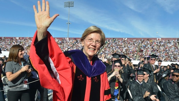 Senator Elizabeth Warren. was the keynote speaker at the 2017 University of Massachusetts Commencement was held at the McGuirk Alumni Stadium in Amherst, Mass., Friday, May 12, 2017.  Warren took a quick jab at President Donald Trump on Friday while urging newly minted University of Massachusetts-Amherst graduates to get more involved in the democracy of public policy and pursue issues they care about.(Don Treeger /The Republican via AP)