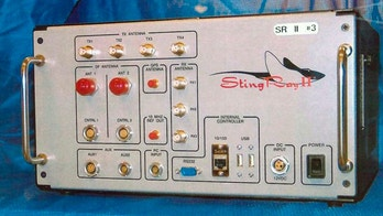 FILE - This undated file photo provided by the U.S. Patent and Trademark Office shows the StingRay II, a cellular site simulator used for surveillance purposes manufactured by Harris Corporation, of Melbourne, Fla. The Department of Homeland Security says it has identified suspected rogue cell tower simulators in Washington. The suspected simulators, known popularly as Stingrays, were detected by a DHS contractor in early 2017 during a 90-day pilot. (U.S. Patent and Trademark Office via AP, File)